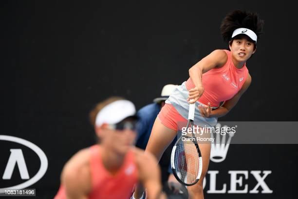 Shuai Zhang of China serves in her first round doubles match with Samantha Stosur of Australia against Viktoria Kuzmova and Magdelena Rybarikova of...