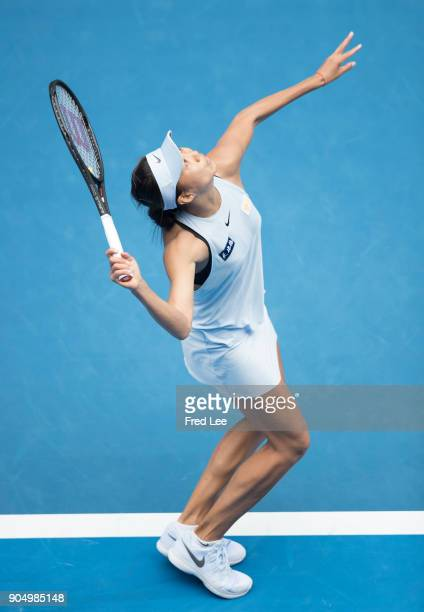 Shuai Zhang of China serves in her first round match against Sloane Stephens of USA on day one of the 2018 Australian Open at Melbourne Park on...