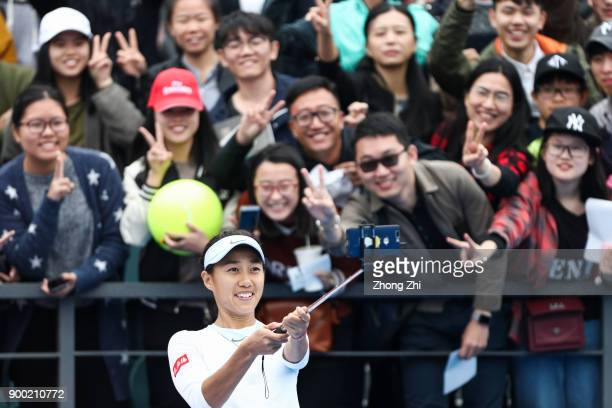 Shuai Zhang of China takes selfie with fans after winning the match against Anna Blinkova of Russia during Day 2 of 2018 WTA Shenzhen Open at...