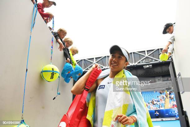 Shuai Zhang of China walks off the court after winning her first round match against Sloane Stephens of the United States on day one of the 2018...