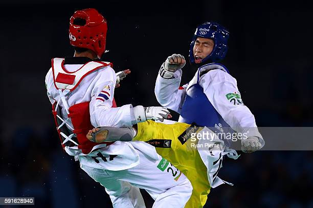 Shuai Zhao of China competes against Tawin Hanprab of Thailand during the Taekwondo Men's 58kg Gold Medal contest during Day 12 of the Rio 2016...