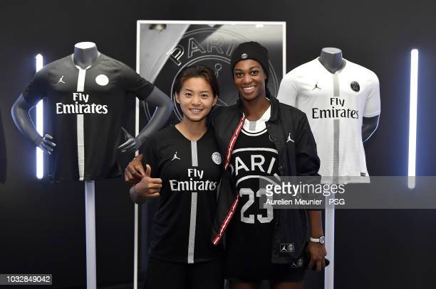 Shuang Wang and MarieAntoinette Katoto of PAris SaintGermain pose during the launch of the new partnership between Paris SaintGermain and Jordan at...