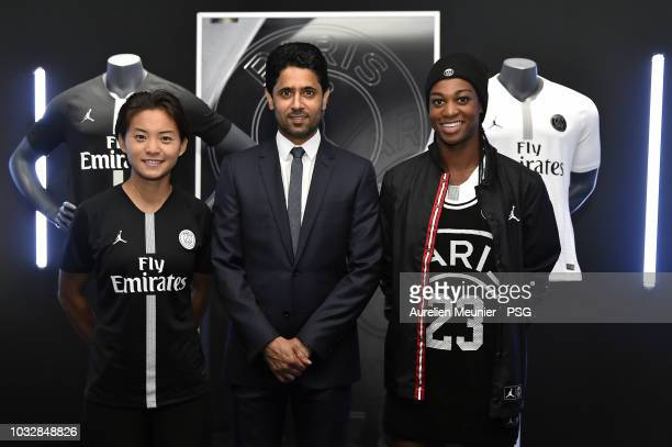 Shuang Wang and MarieAntoinette Katoto pose with Paris SaintGermain President Nasser Al Khelaifi during the launch of the new partnership between...