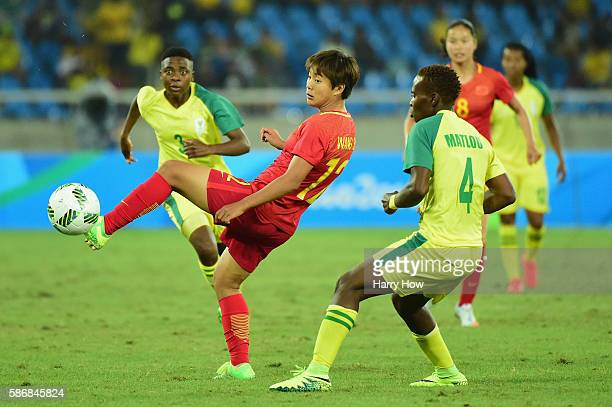 Shuang Wang of China controls the ball during the Women's Group E first round match between South Africa and China PR on Day 1 of the Rio 2016...