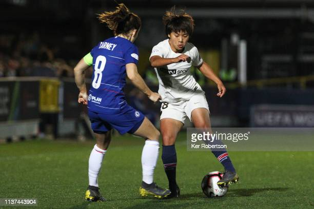 Shuang Wang of Paris SaintGermain Women is challenged by Karen Carney of Chelsea Women during the UEFA Women's Champions League Quarter Final First...