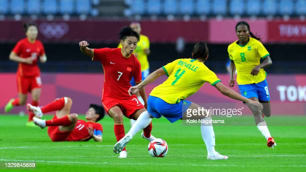 Shuang Wang of Team China is closed down by Rafaelle of Team Brazil during the Women's First Round Group F match between China and Brazil during the...