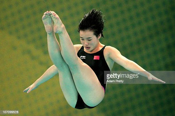Shuangxue Zheng of China competes in the Women's 1m Springboard Final at Aoti Aquatics Centre during day twelve of the 16th Asian Games Guangzhou...