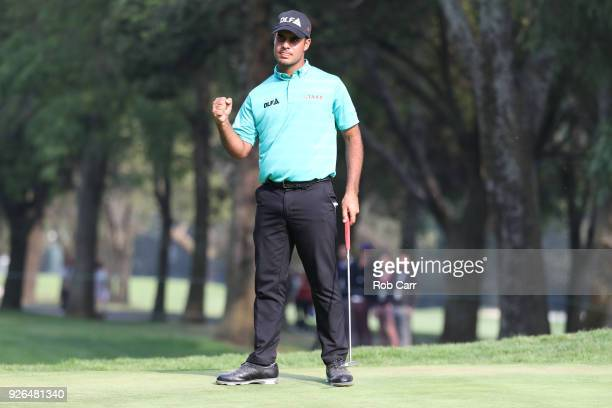 Shubhankar Sharma of India after sinking a birdie putt on the 18th hole to go 11 for the tournament during the second round of World Golf...