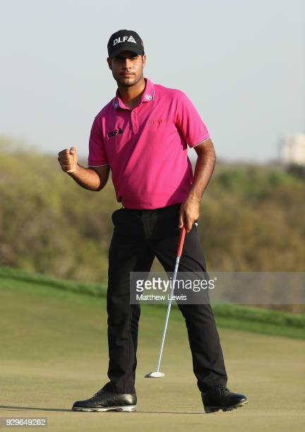 Shubhankar Sharma of India celebrates a birdie putt on the 17th green during day two of the Hero Indian Open at Dlf Golf and Country Club on March 9...