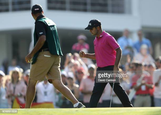 Shubhankar Sharma of India celebrates after holing a par putt on the 18th hole during the third round of the World Golf ChampionshipsMexico...