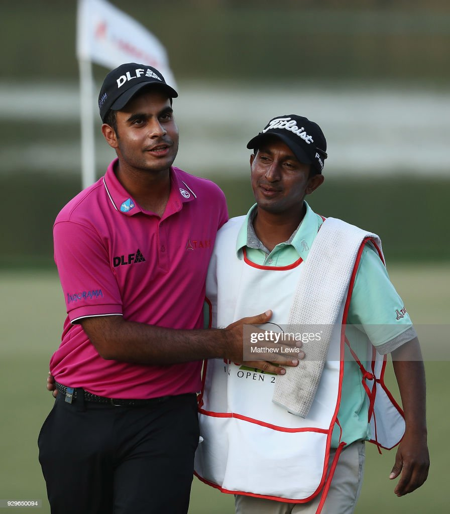 Shubhankar Sharma of India celebrates his round with his caddie after day two of the Hero Indian Open at Dlf Golf and Country Club on March 9, 2018 in New Delhi, India.