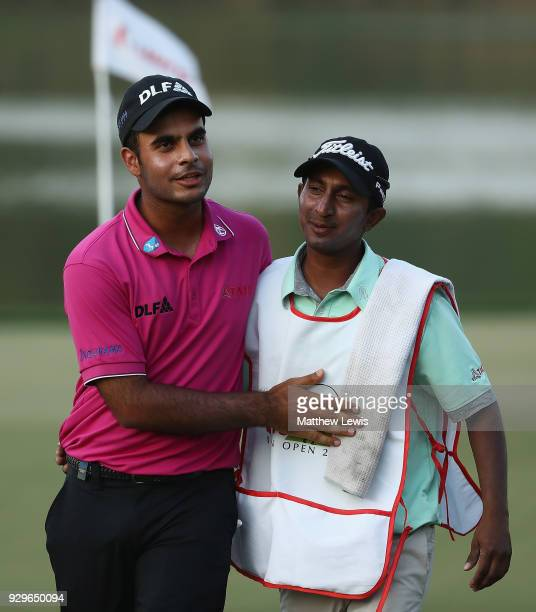 Shubhankar Sharma of India celebrates his round with his caddie after day two of the Hero Indian Open at Dlf Golf and Country Club on March 9 2018 in...