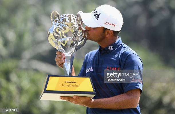 Shubhankar Sharma of India kisses the trophy during day four of the Maybank Championship Malaysia at Saujana Golf and Country Club on February 4 2018...