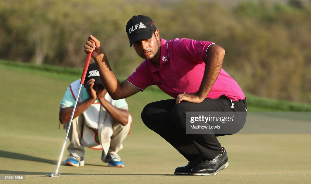 Shubhankar Sharma of India lines up a putt on the 17th green during day two of the Hero Indian Open at Dlf Golf and Country Club on March 9, 2018 in New Delhi, India.