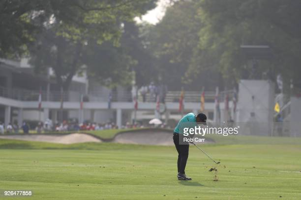 Shubhankar Sharma of India plays his second shot into the 18th hole during the second round of World Golf Championships-Mexico Championship at Club...