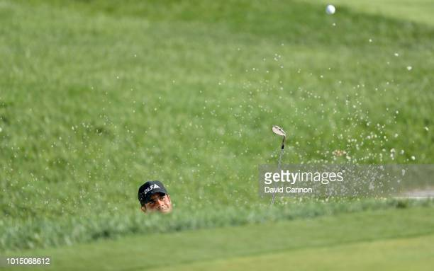 Shubhankar Sharma of India plays his third shot on the 15th hole during the completion of the weather delayed second round of the 100th PGA...