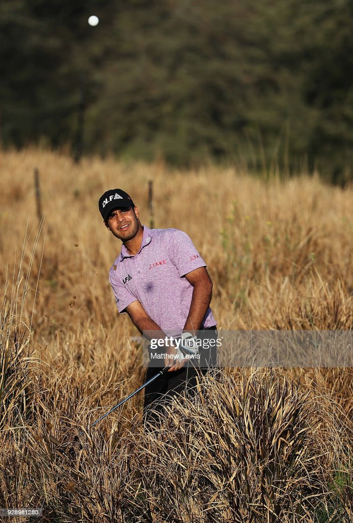 Shubhankar Sharma of India plays out of the rough on the 11th hole during day one of the Hero Indian Open at Dlf Golf and Country Club on March 8, 2018 in New Delhi, India.