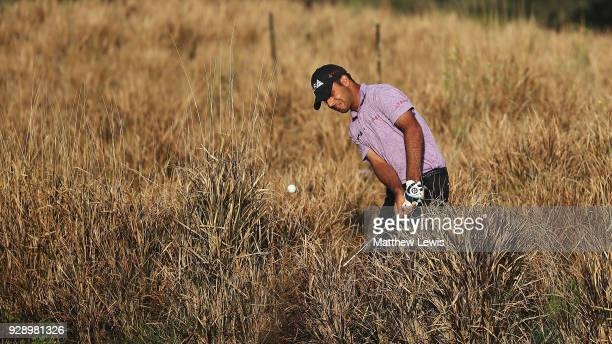 Shubhankar Sharma of India plays out of the rough on the 11th hole during day one of the Hero Indian Open at Dlf Golf and Country Club on March 8,...