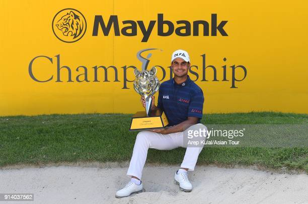 Shubhankar Sharma of India pose with the trophy after winning the 2018 Maybank Championship at Saujana Golf and Country Club on February 4 2018 in...