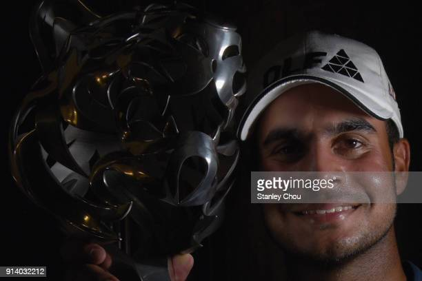 Shubhankar Sharma of India poses with the Maybank Championship trophy after he won it 21 under 267 during day four of the Maybank Championship...
