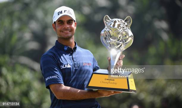 Shubhankar Sharma of India poses with the trophy after winning the Maybank Championship Malaysia at Saujana Golf and Country Club on February 4 2018...