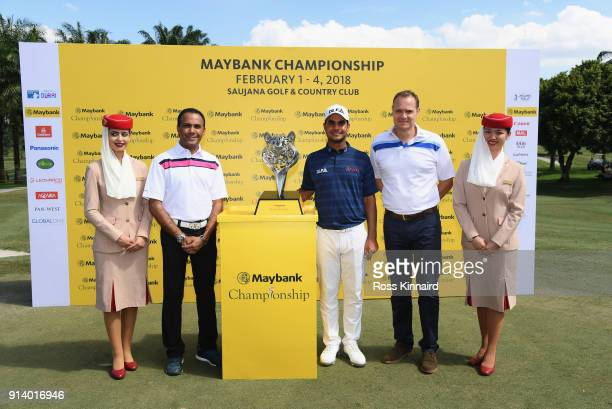 Shubhankar Sharma of India poses with the trophy and the prize presentation party during day four of the Maybank Championship Malaysia at Saujana...
