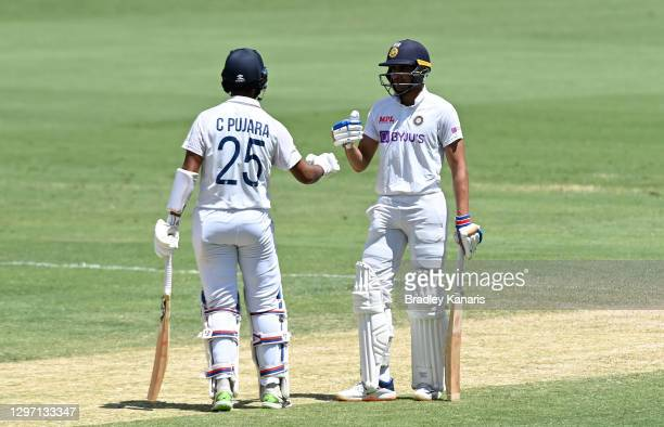 Shubman Gill and Cheteshwar Pujara of India celebrate during day five of the 4th Test Match in the series between Australia and India at The Gabba on...