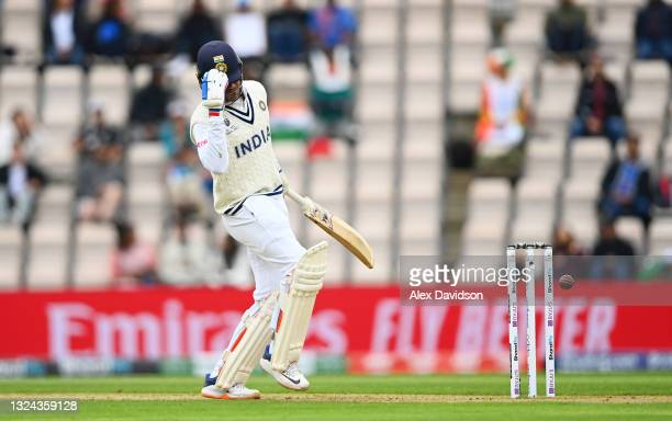 Shubman Gill of India is struck in the helmet by Kyle Jamieson of New Zealand during Day 2 of the ICC World Test Championship Final between India and...