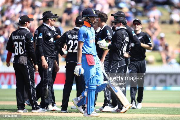Shubman Gill of India leaves the field after being caught and bowled by Trent Boult of New Zealand during game four of the One Day International...