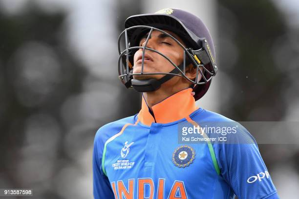 Shubman Gill of India reacts as he walks out to bat during the ICC U19 Cricket World Cup Final match between Australia and India at Bay Oval on...