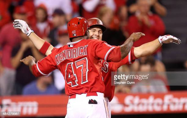 B Shuck and Howie Kendrick of the Los Angeles Angels of Anaheim celebrate after both score on Shuck's two run home run in sixth inning against the...