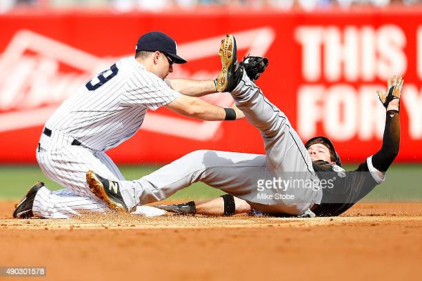 B Shuck of the Chicago White Sox is tagged out by Dustin Ackley of the New York Yankees trying to steal second base in the second inning at Yankee...