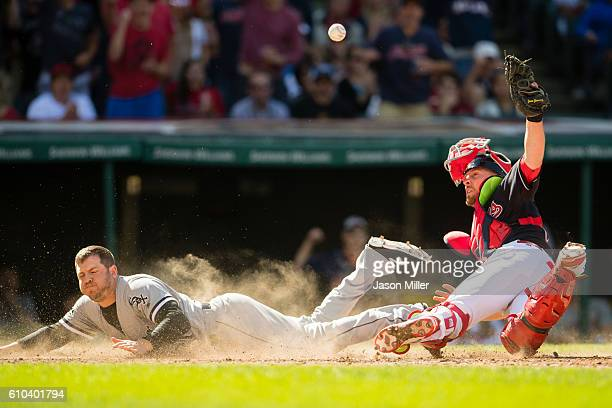 B Shuck of the Chicago White Sox scores on a sacrifice fly by Carlos Sanchez as catcher Chris Gimenez of the Cleveland Indians drops the ball during...
