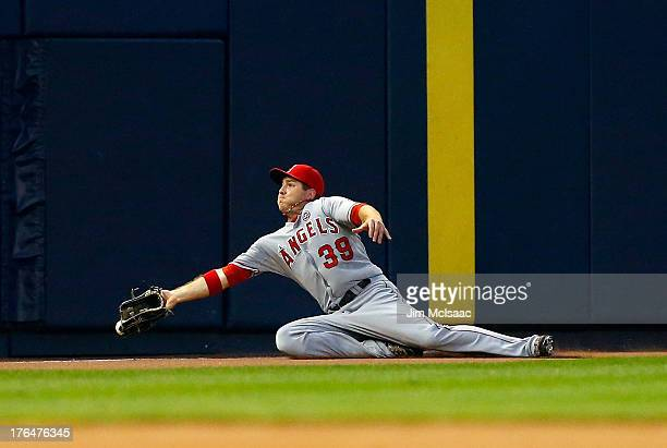 B Shuck of the Los Angeles Angels of Anaheim can't come up with a ball hit for a second inning double by Lyle Overbay of the New York Yankees at...