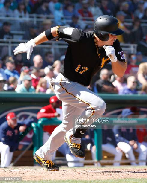 Shuck of the Pittsburgh Pirates runs to first base after hitting the ball against the Boston Red Sox during a spring training game at JetBlue Park on...