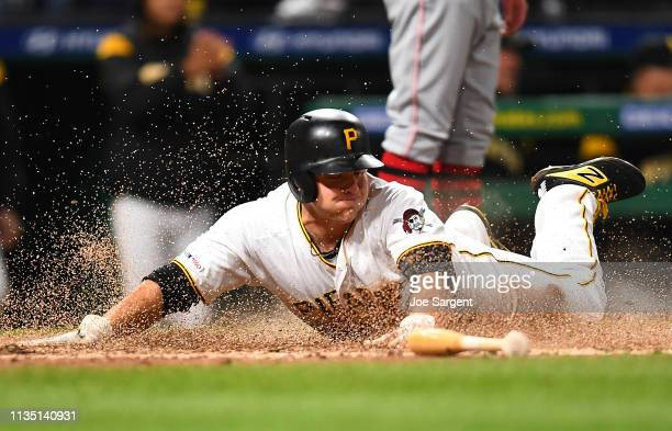 Shuck of the Pittsburgh Pirates scores during the eighth inning against the Cincinnati Reds at PNC Park on April 5 2019 in Pittsburgh Pennsylvania