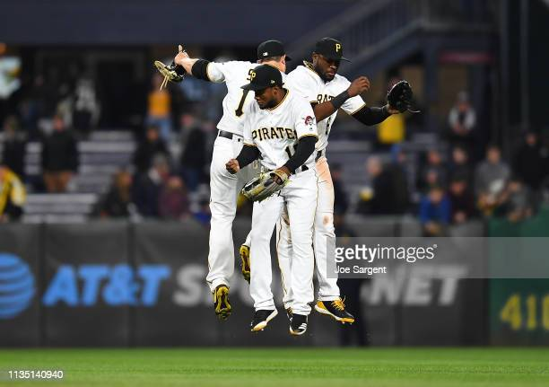 Shuck, Pablo Reyes and Starling Marte of the Pittsburgh Pirates celebrate after a 2-0 win over the Cincinnati Reds at PNC Park on April 5, 2019 in...