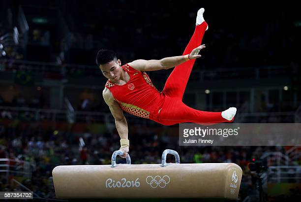Shudi Deng of China competes on the pommel horse during the men's team final on Day 3 of the Rio 2016 Olympic Games at the Rio Olympic Arena on...