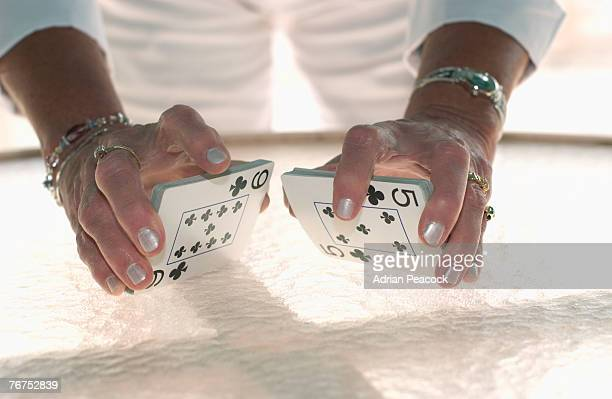 shuffling a deck of cards - shuffling stock photos and pictures