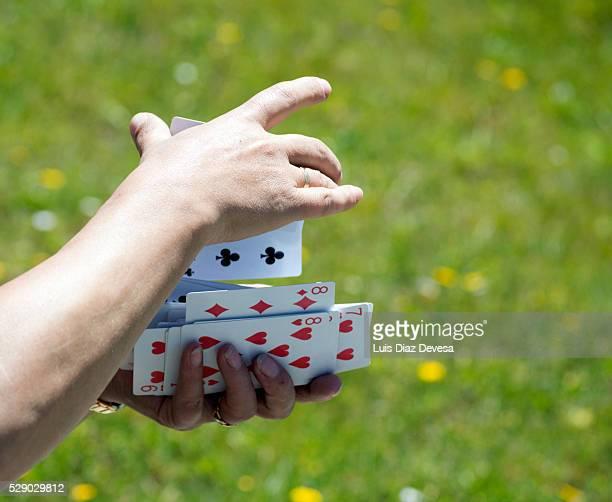 shuffling cards, close-up of hands
