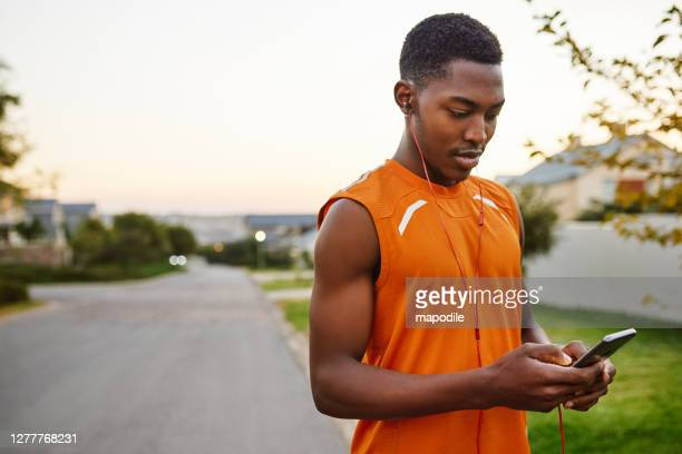 shuffling his workout playlist - borough district type stock pictures, royalty-free photos & images