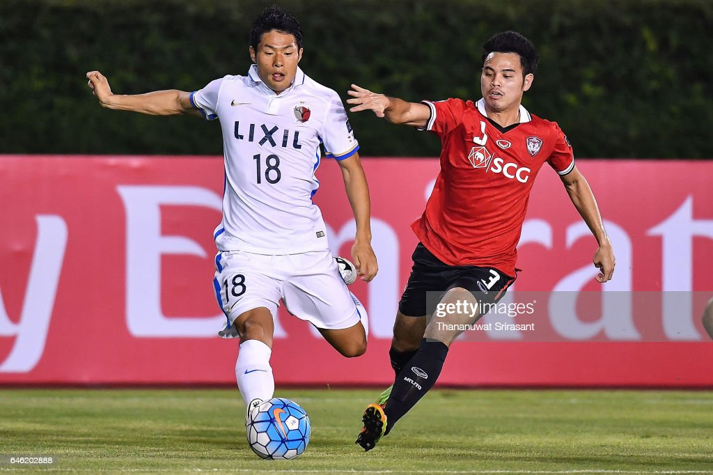 Shuhei Akasaki #18 of Kashima Antlers (L) and Theerathon Bunmathan #3 of Muangthong United (R) competes for the ball during the AFC Asian Champions League match between Muangthong United and Kashima Antlers at Supachalasai National Stadium on February 28, 2017 in Bangkok, Thailand.