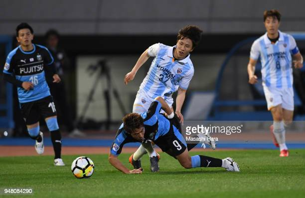 Shuhei Akasaki of Kawasaki Frontale and Lee Yeongjae of Ulsan Hyundai compete for the ball during the AFC Champions League Group F match between...