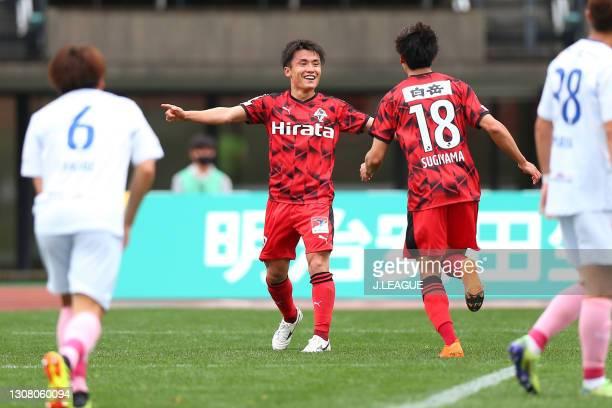 Shuhei Kamimura of Roasso Kumamoto celebrates scoring his side's second goal with his team mate Naohiro Sugiyama during the J.League Meiji Yasuda J3...