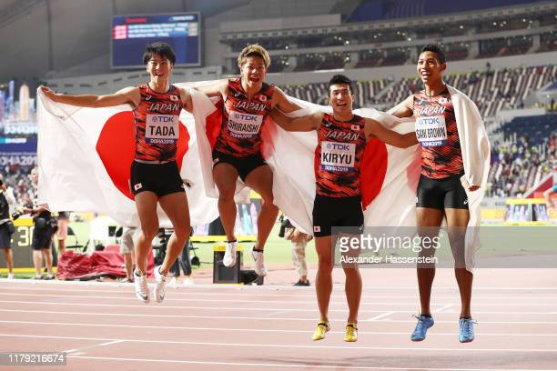 Shuhei Tada, Kirara Shiraishi, Yoshihide Kiryu and Abdul Hakim Sani Brown of Japan celebrate bronze in the Men's 4x100 Metres Relay during day nine...