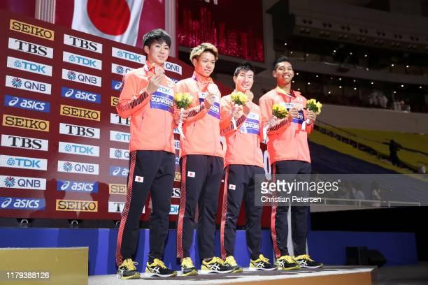 Shuhei Tada, Kirara Shiraishi, Yoshihide Kiryu and Abdul Hakim Sani Brown of Japan, bronze, pose during the medal ceremony for the Men's 4x100 Metres...