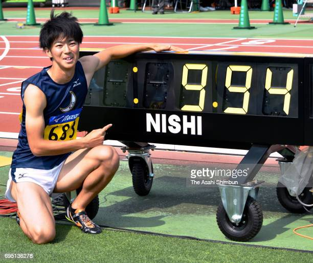 Shuhei Tada of Kwansei Gakuin University poses for photographs after competing in the Men's 100m semifinal during the All Japan University Students...
