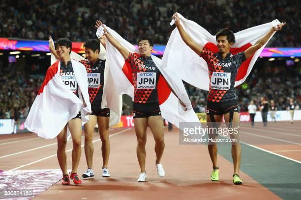 Shuhei Tada Shota Iizuka Yoshihide Kiryu and Kenji Fujimitsu of Japan celebrate winning bronze in the Men's 4x100 Relay final during day nine of the...