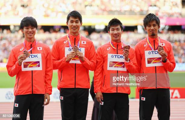 Shuhei Tada Shota Iizuka Yoshihide Kiryu and Kenji Fujimitsu of Japan bronze pose with their medals for the Men's 4x100 Metres Relay during day ten...