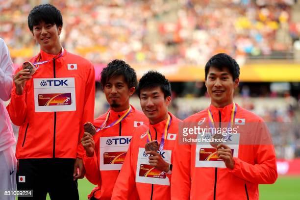 Shuhei Tada Shota Iizuka Yoshihide Kiryu and Kenji Fujimitsu of Japan bronze pose with their medals for the Men's 4x100 Metres Relay during day ten...